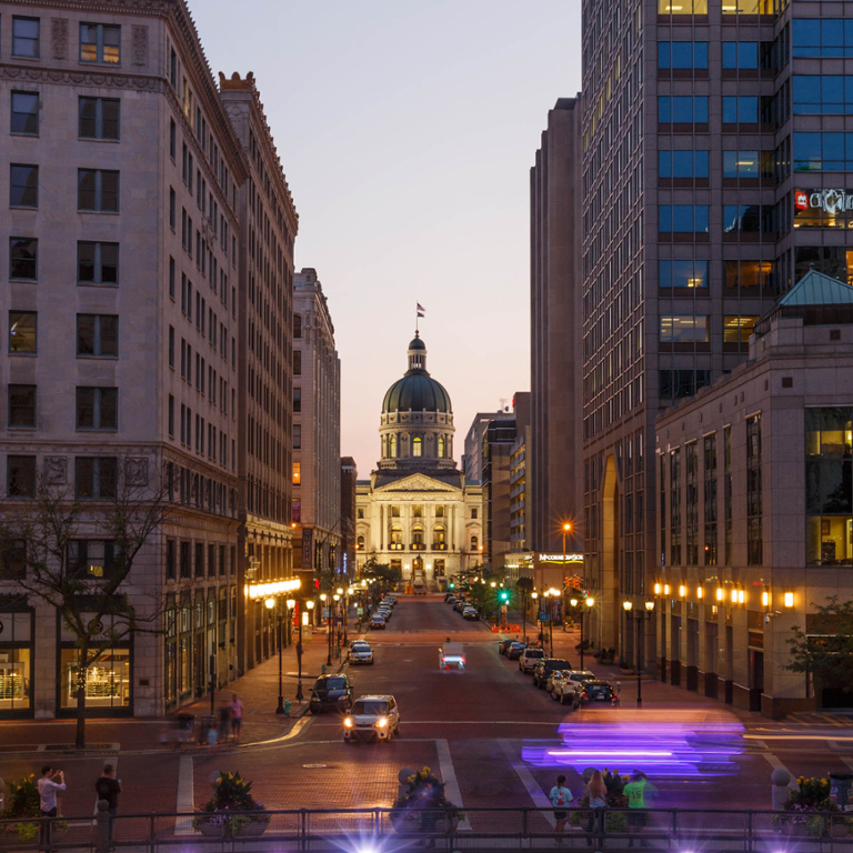 Downtown Indianapolis at night, with a view of the capitol building